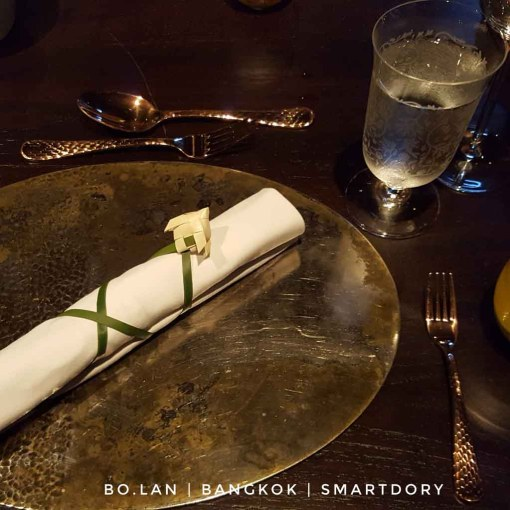 Table setting with napkin wrapped with a pandan leaf
