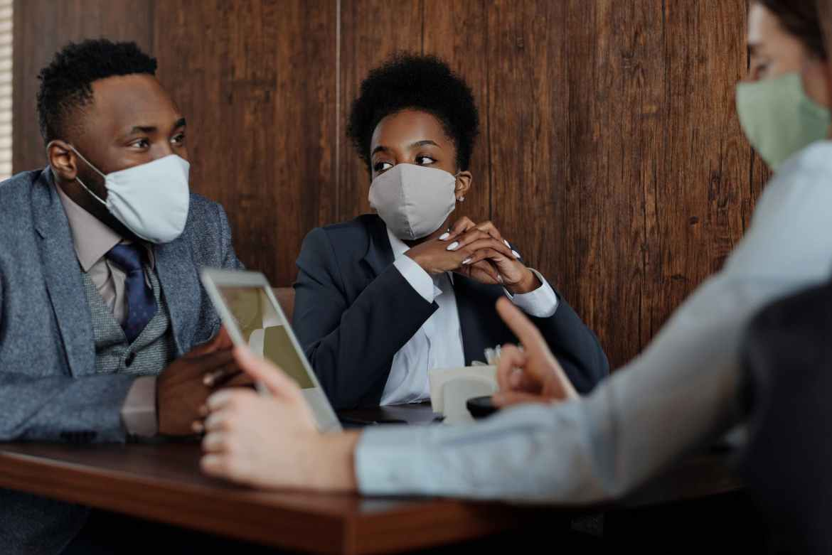 how to sell insurance virtually business people wearing face masks and talking