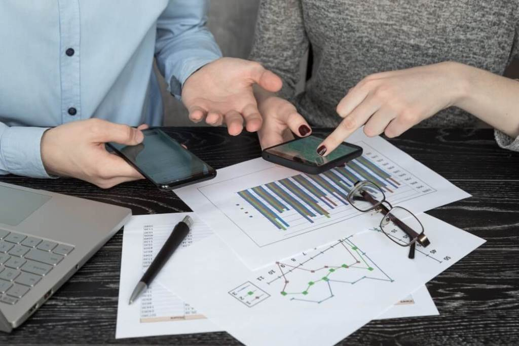 Business Colleagues using mobile apps