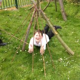 Forest school den in use
