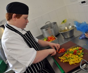 Matthew (Yr9) chops peppers for the salsa.