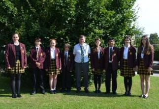 Assistant Headteacher, Mr Willer with students from the Student Voice Community Group