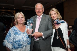 Mr Wood with his family at the award ceremony in London on Friday.