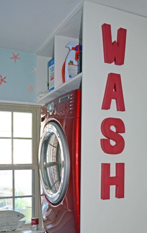 Red WASH letters stacked washer dryer