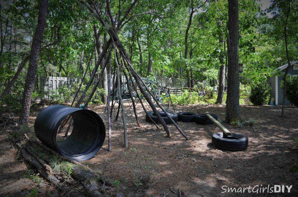 Backyard fun - teepee, tires, pipe to crawl through