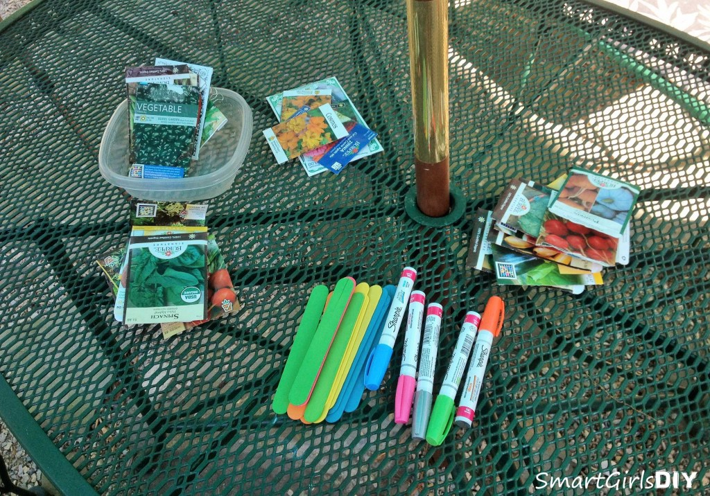 Planting fruit and vegetable seeds and making plant markers