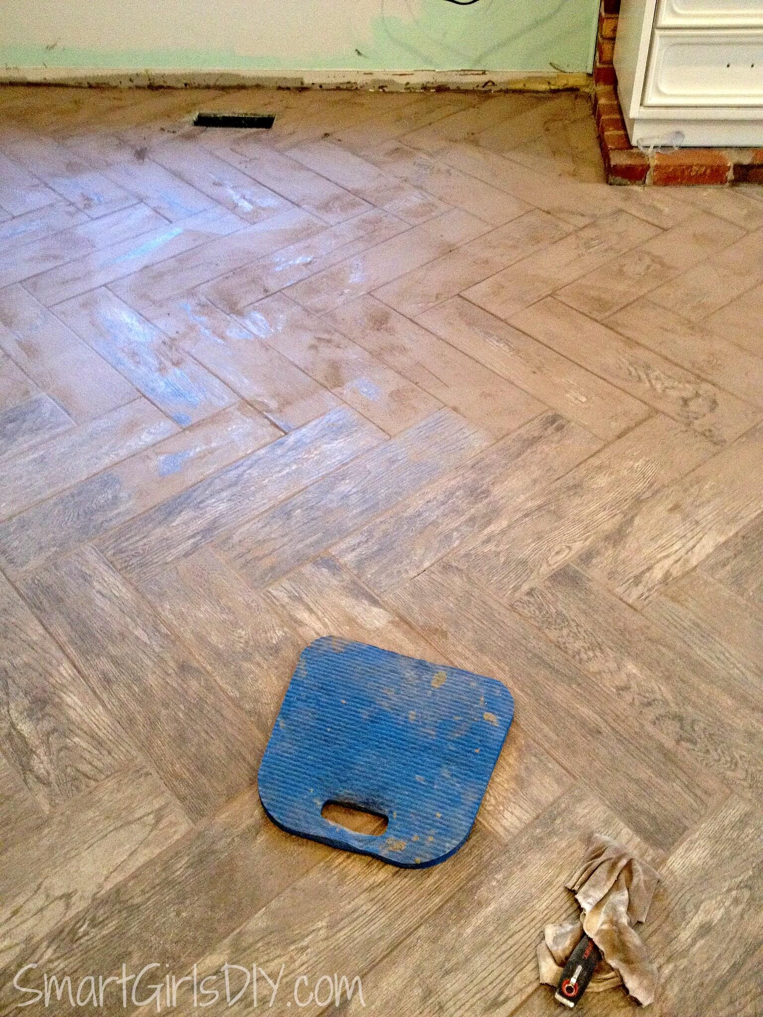 Grouting a herringbone tile floor family room 11 labor of love cleaning grout off tile dailygadgetfo Gallery