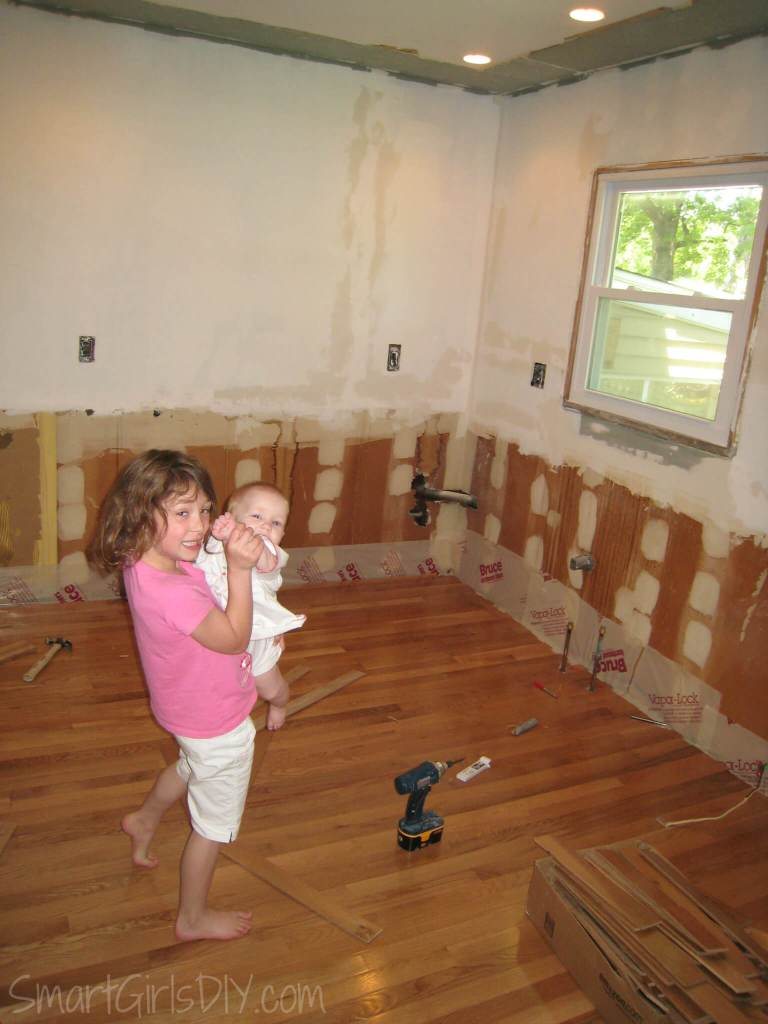 DIY Kitchen remodel - removed soffit, installed hardwood floors, new window, drywall