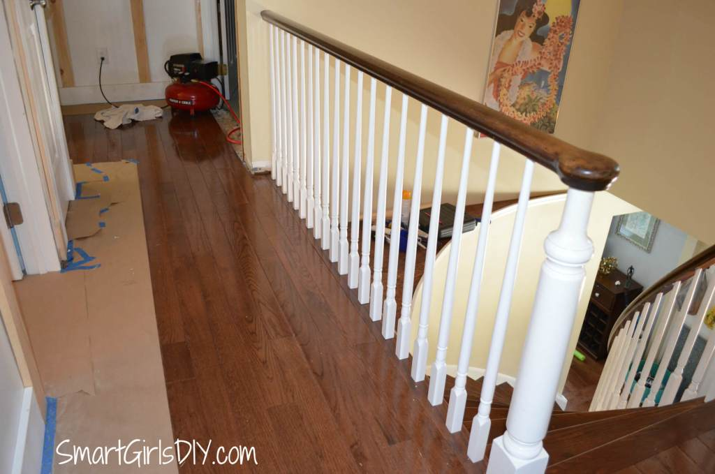 Upstairs hallway DIY transformation -- carpet to hardwood plus a way to work around the spindles