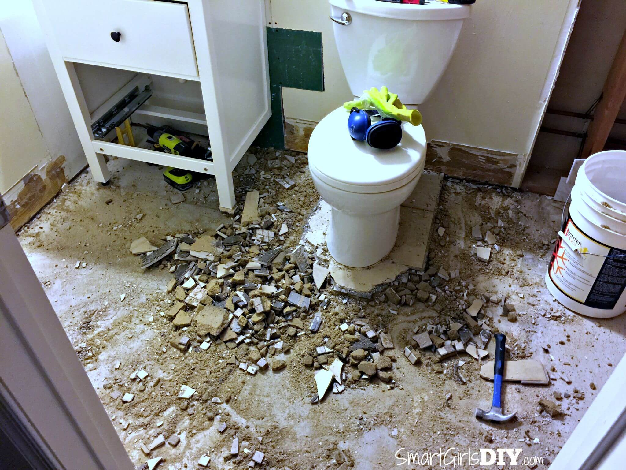 Guest bathroom 7 diy hex tile floor demo tile bathroom floor still using toiled and sink dailygadgetfo Image collections