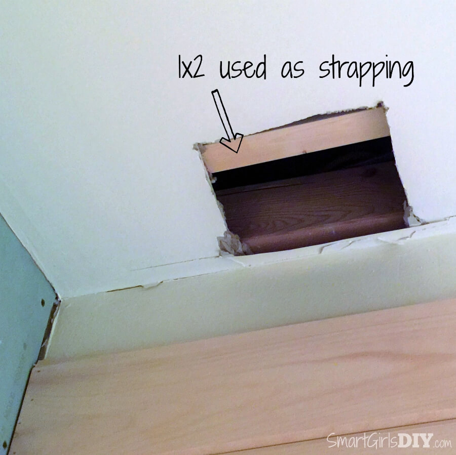 Use scrap wood for strapping to patch drywall hole