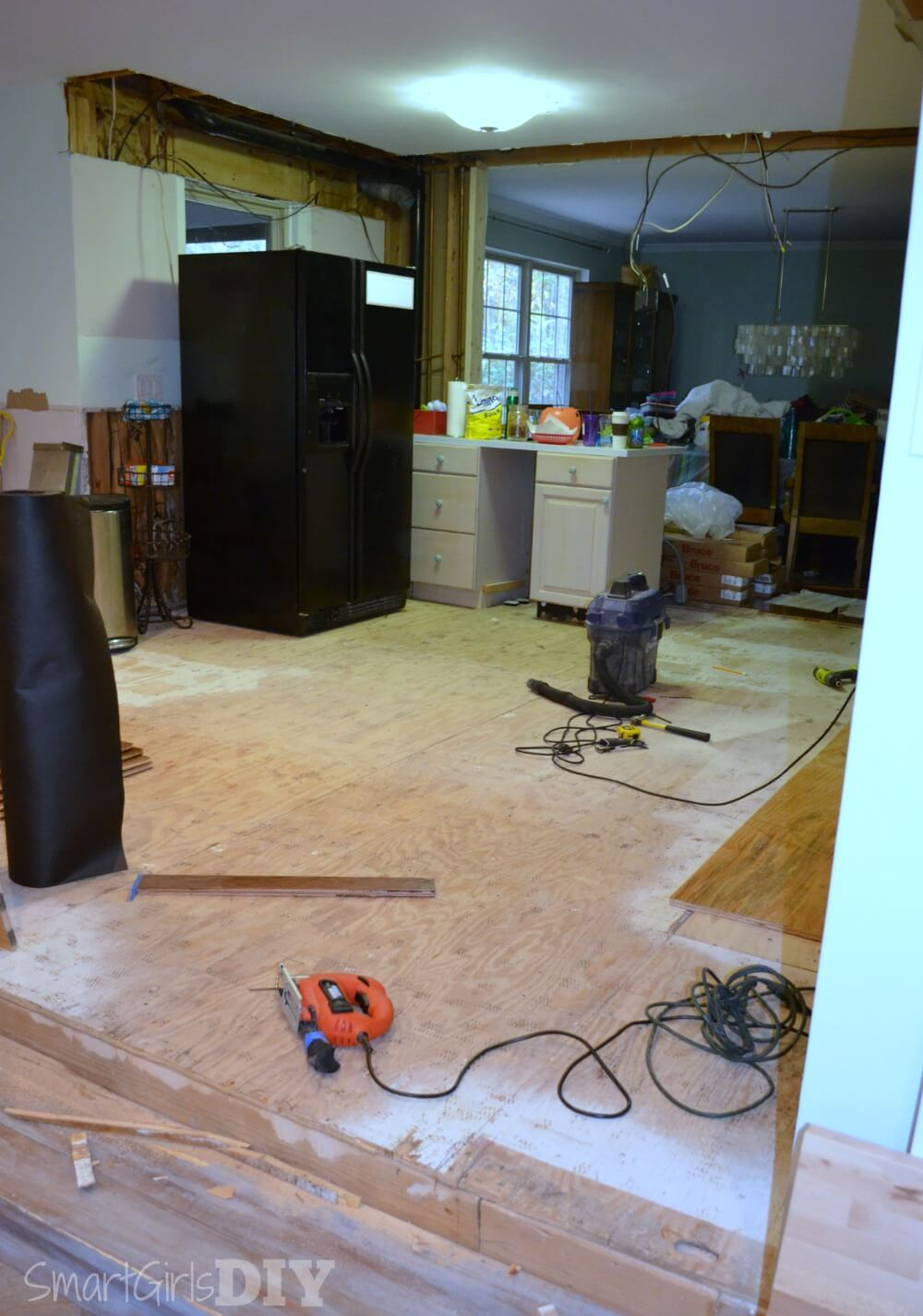 Getting read to install hardwood floors in the kitchen