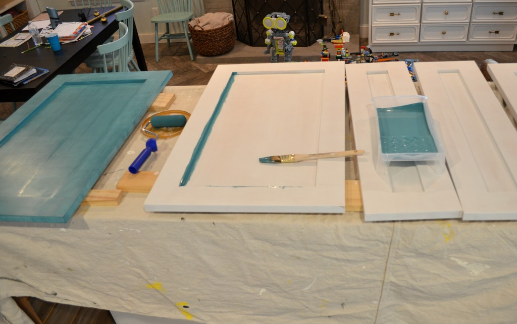 priming teal kitchen cabinet doors