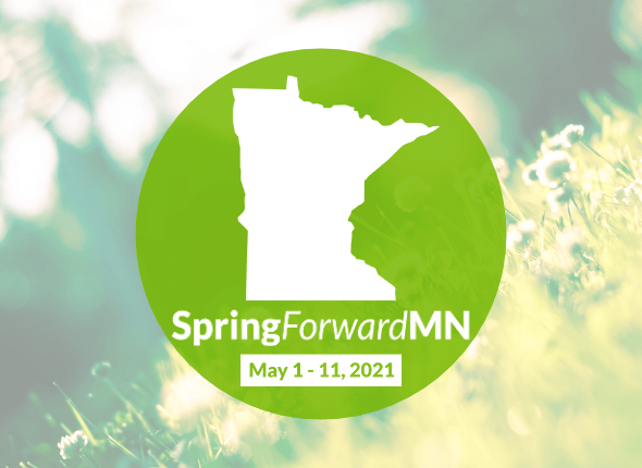 A logo for GiveMN's Spring Forward MN event, with the dates May 1-11, 2021. The green circular logo also includes the state of Minnesota, and is placed over a bright, sunny photo of small white flowers.