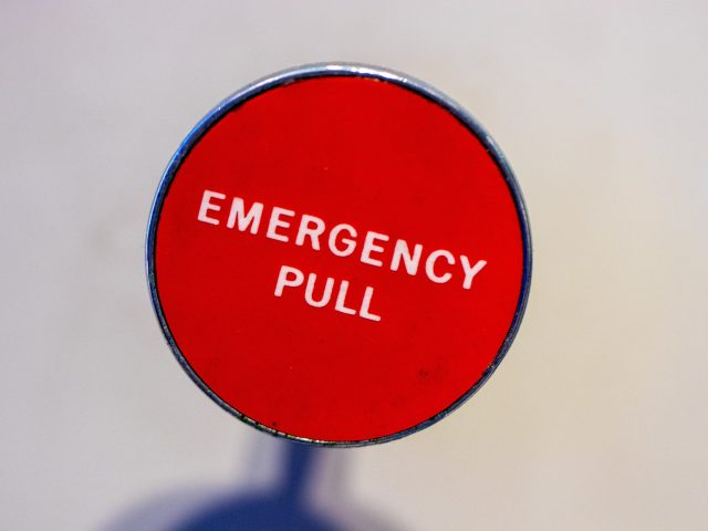 Small business crisis pic of an emergency button