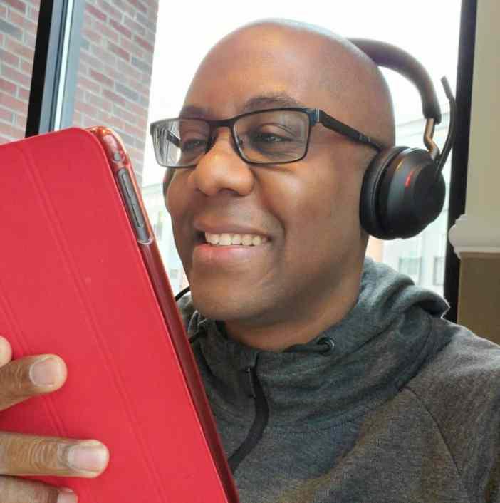 Ramon with headphones and iPad
