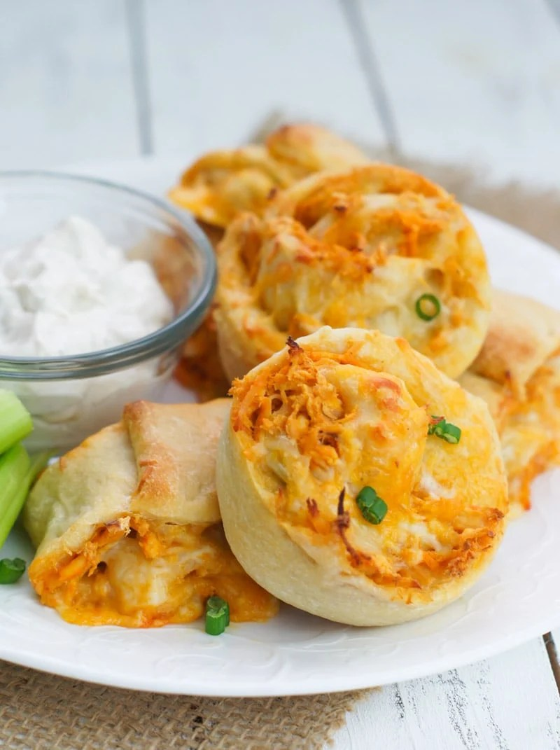Spicy, cheesy and absolutely delicious, these super easy buffalo chicken rolls are the perfect snack to share with your guest on Super Bowl night.