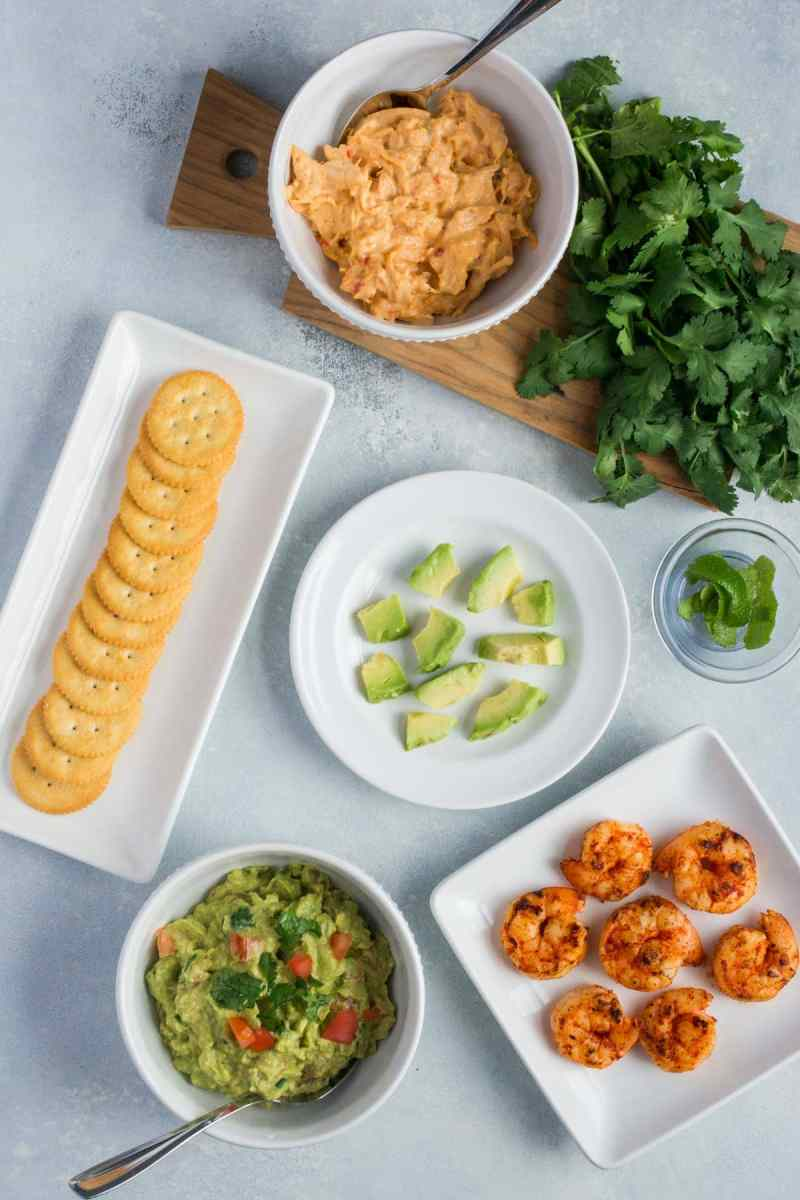 Spicy Shrimp and Guacamole Bites ~ Seared spicy shrimp and guacamole layered onto individual RITZ Crackers. A super easy appetizer that's perfect for entertaining! #ad