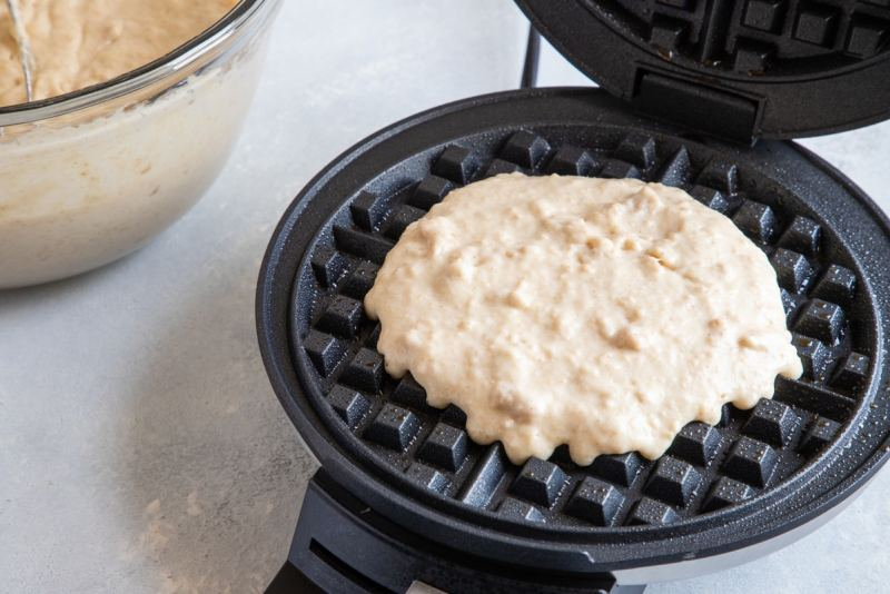 Churro Waffles batter in a waffle maker