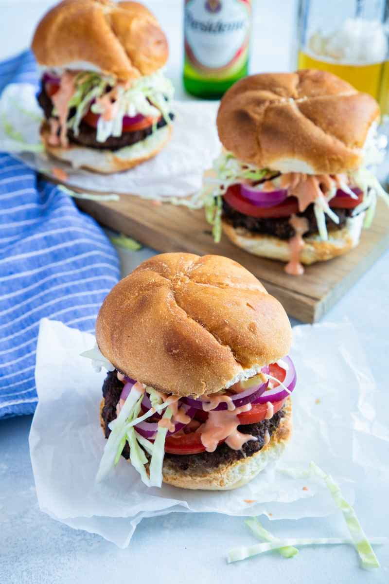 Dominican Chimi Burger with tomato, onion, shredded cabbage and mayo-ketchup sauce.