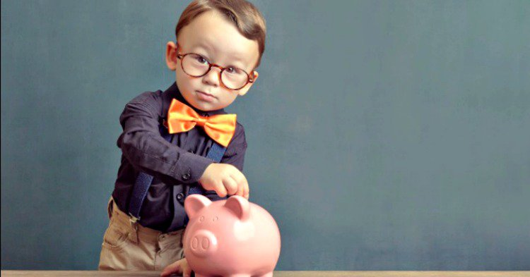 toddler genius saving money in piggy bank