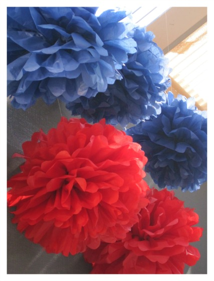 red and blue tissue paper pom poms