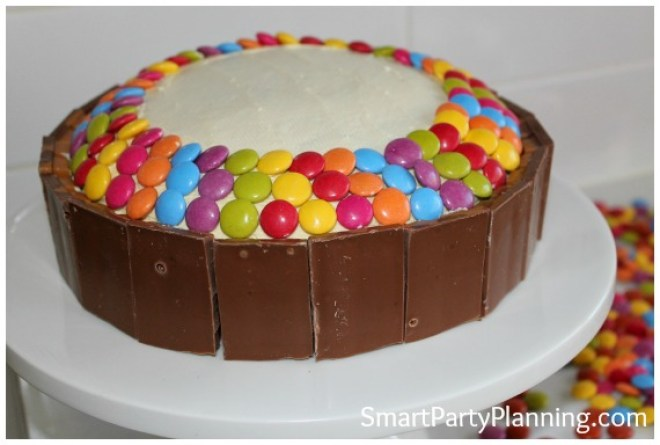 Add smarties to the top of a cake