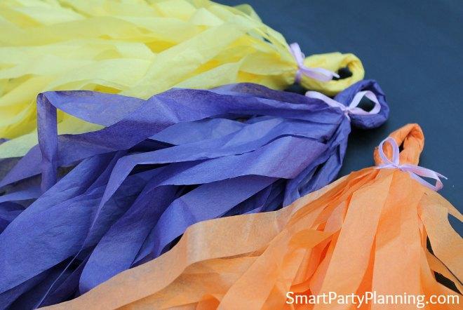 yellow, purple and orange tissue paper tassels