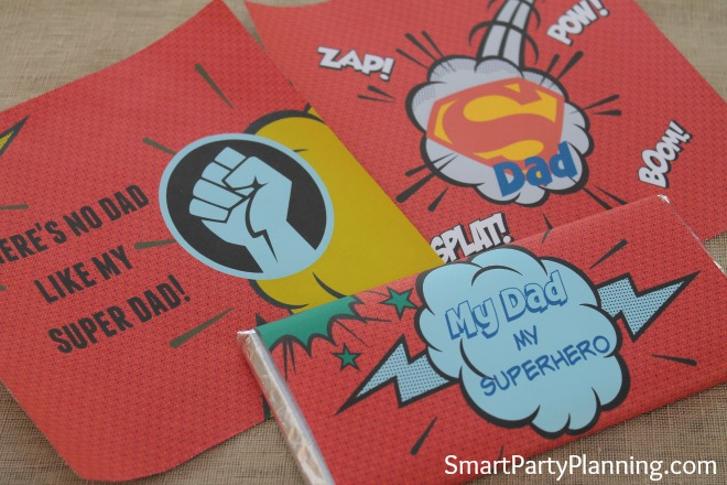 These superhero printables are the perfect gift for Father's day or dad's birthday. They are designed for Hershey bar wrappers and what dad doesn't like his chocolate! If you are looking for gifts from the kids, this one is easy to organize and will be great for their little budget. Dad will love it, and the kids will be excited crafting it together. It's a winner for everyone, especially the superhero dad!