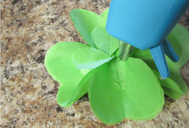 Tissue paper is fantastic for crafting. For DIY crafts that are inexpensive, but look great, using tissue paper is the way to go. These cute tissue paper four leaf clovers are perfect to use for toppers or treats. Sprucing up your decorating for St Patricks day couldn't be easier, and it's a great craft idea to get the kids involved with. You won't believe how easy they are to make.