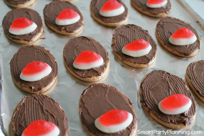 Place the nose on the reindeer cookies
