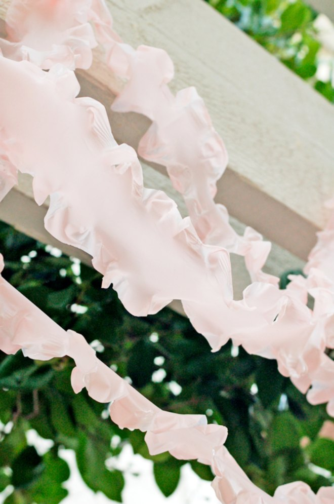 Pink ruffled plastic tablecloth streamers