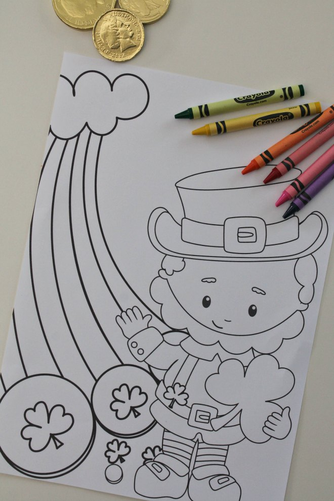 Leprechaun coloring sheet standing by a rainbow