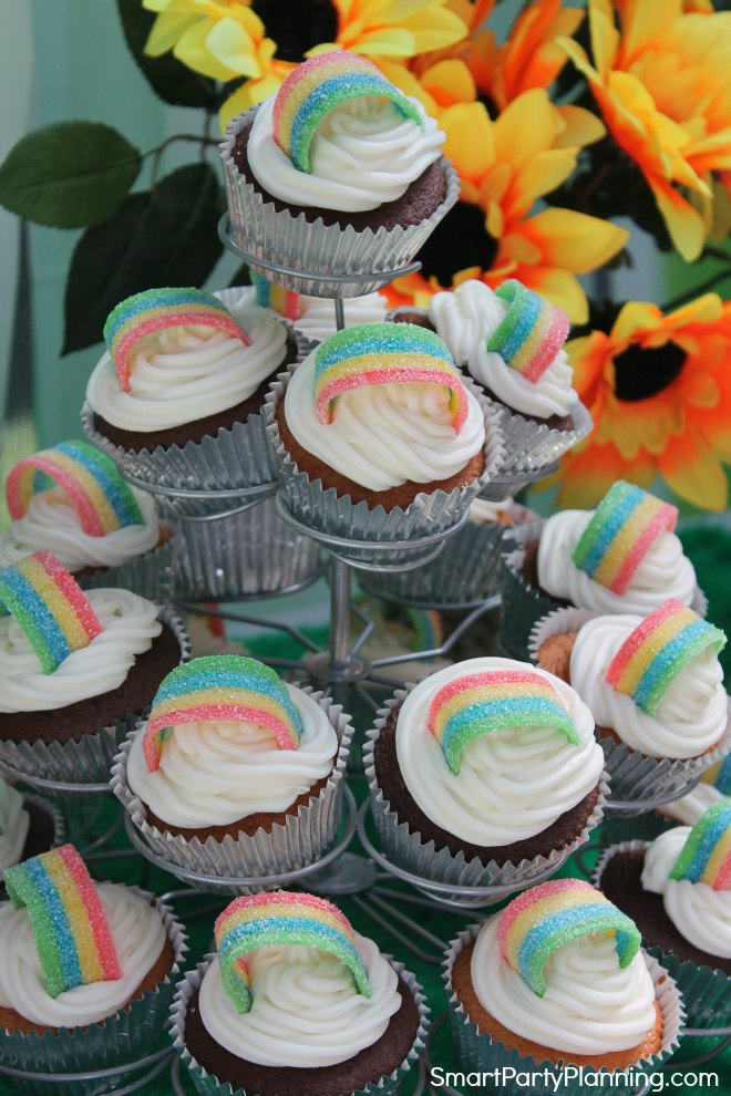 stand of rainbow cupcakes