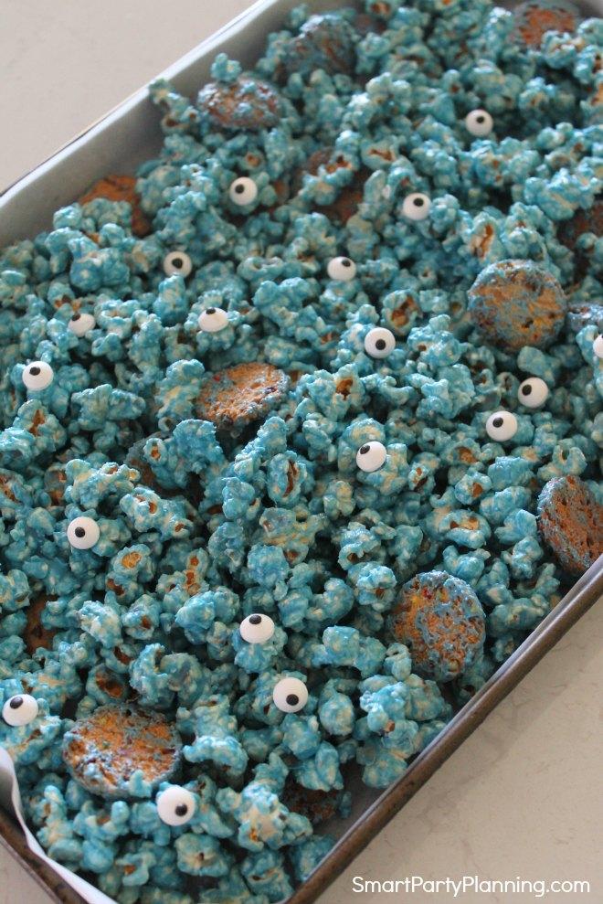 Add candy eyes to make monster popcorn
