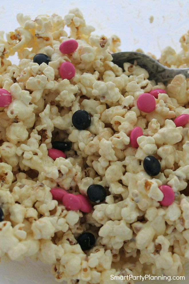 Mix smarties in with popcorn