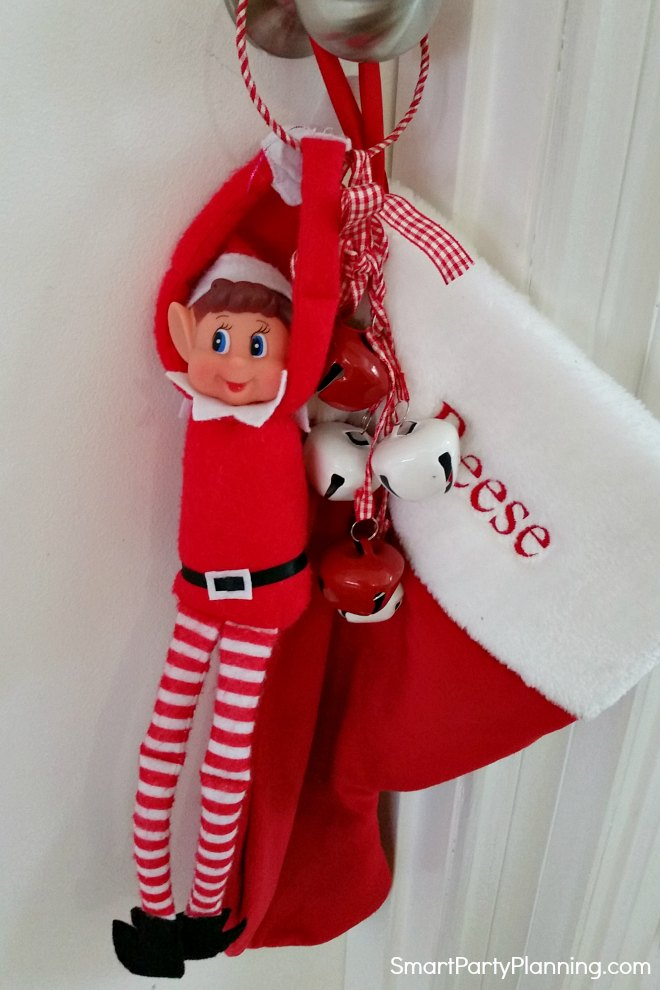 elf on the shelf playing with a stocking