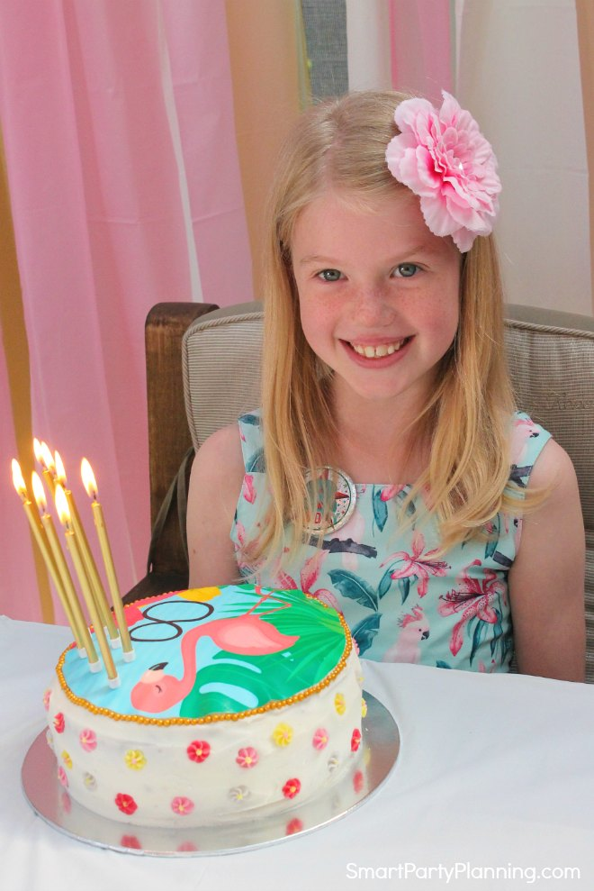 Flamingo Birthday cake with little girl