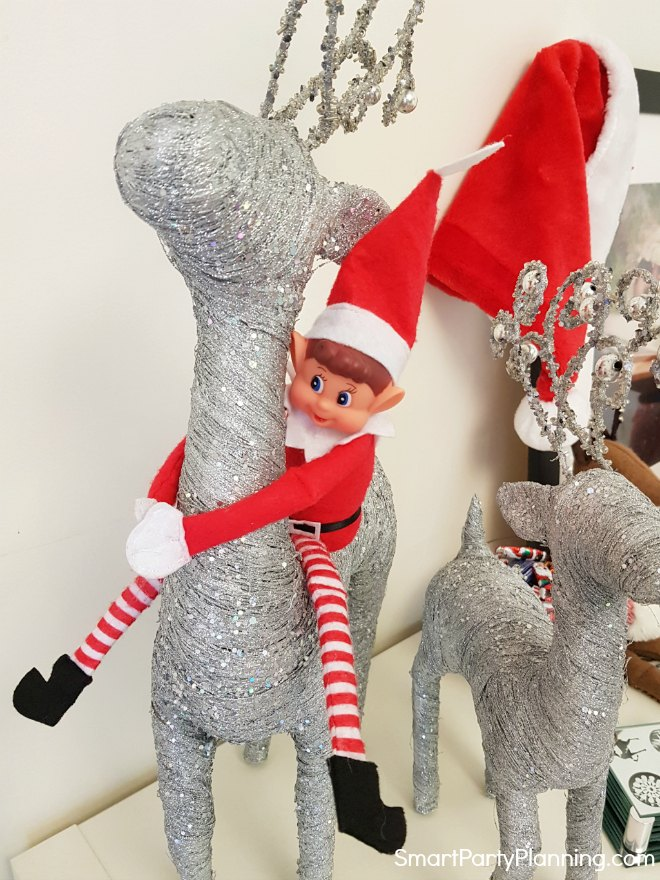 Elf on the Shelf rides a reindeer