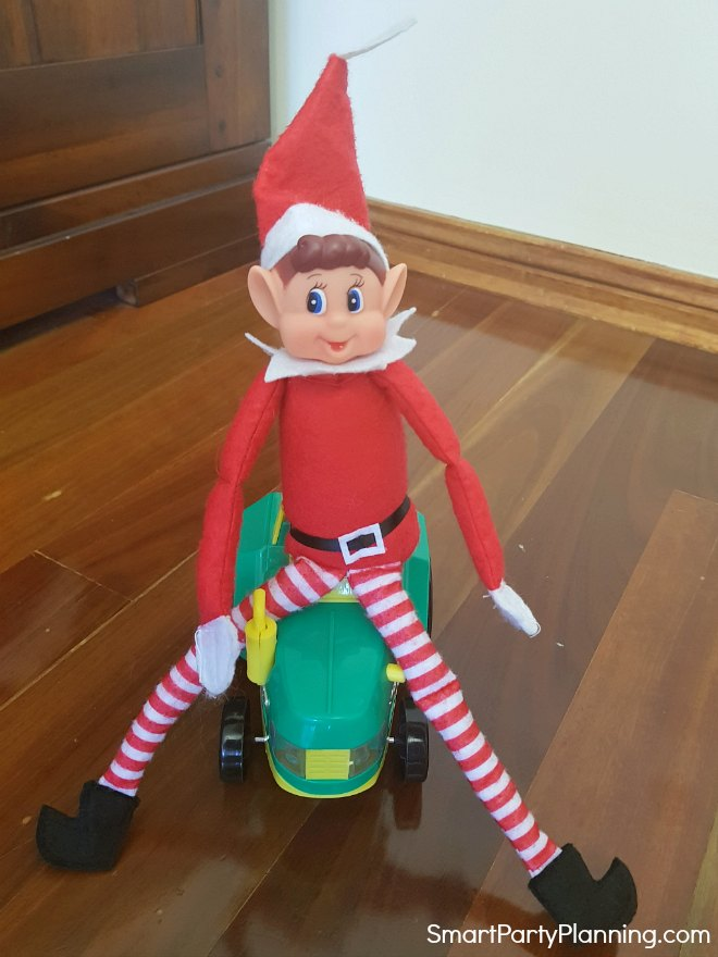 Elf on the Shelf rides a tractor