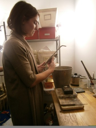 Emilie uses a torch to melt the metal into different types of shapes.