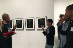 Students anaylzing digital art by Miljohn Ruperto. On view at the Whitney Museum of American Art.