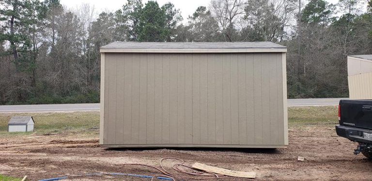 side view of grey shed