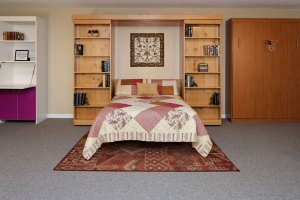 Library Murphy Bed hidden behind bookcase, with cabinets, shelves, drawers. Bookcase slides to reveal fold-down bed.