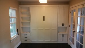 Guest bedroom makeover, custom Murphy bed installed, vertical, wall to wall, small spaces, custom cabinetry, traditional style. SmartSpaces.com