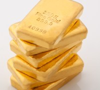 Gold bars represent real money vs. imaginary digital currency