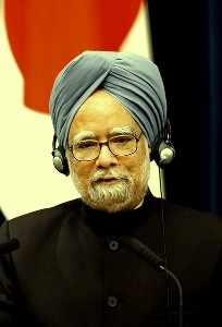 Prime Minister Manmohan Singh reiterated that Centre will go ahead with the disinvestment in public sector undertakings (PSUs).