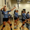 Sophomore Sarah Nesler and the rest of the sophomore team warm up before the match. Photo by Hailey Hughes