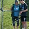 Senior Chris Schreiber takes a second to talk to Coach KJ. Photo by Hailey Hughes