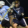 Junior Nic Bailey shields the ball from from an Aquinas defender. Photo by Andrew McKittrick